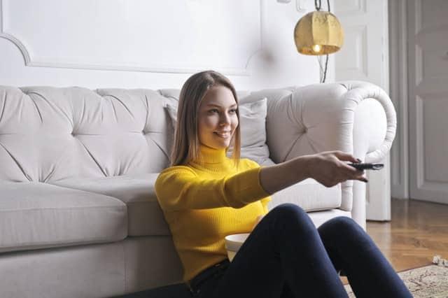 woman sitting on floor watching tv